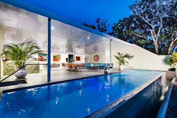 Luxury beachside villa with infinity pool and modern kitchen
