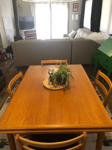 Dining table ready for 4 people but can sit 6