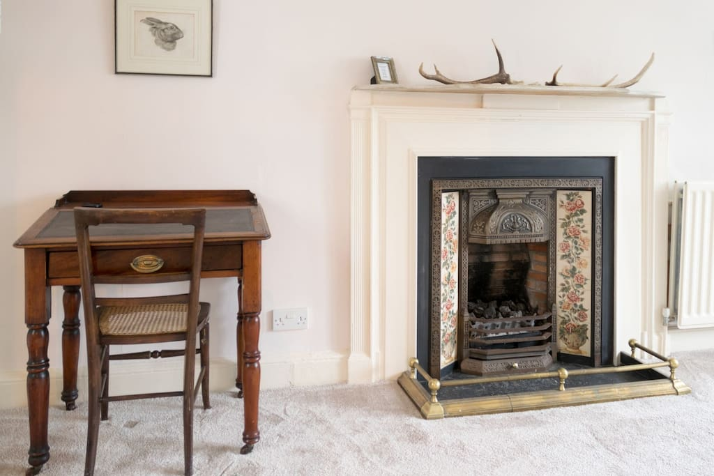 Antique Desk and Feature Fireplace