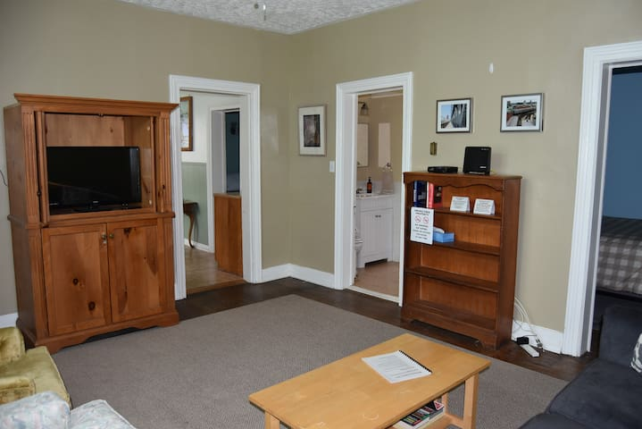 Hideaway flat screen television and high speed Wi-Fi provide options for entertainment as well as work.