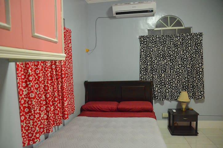 Master Bedroom with ensuite bathroom. Samsung Split-type Aircon with remote control.
