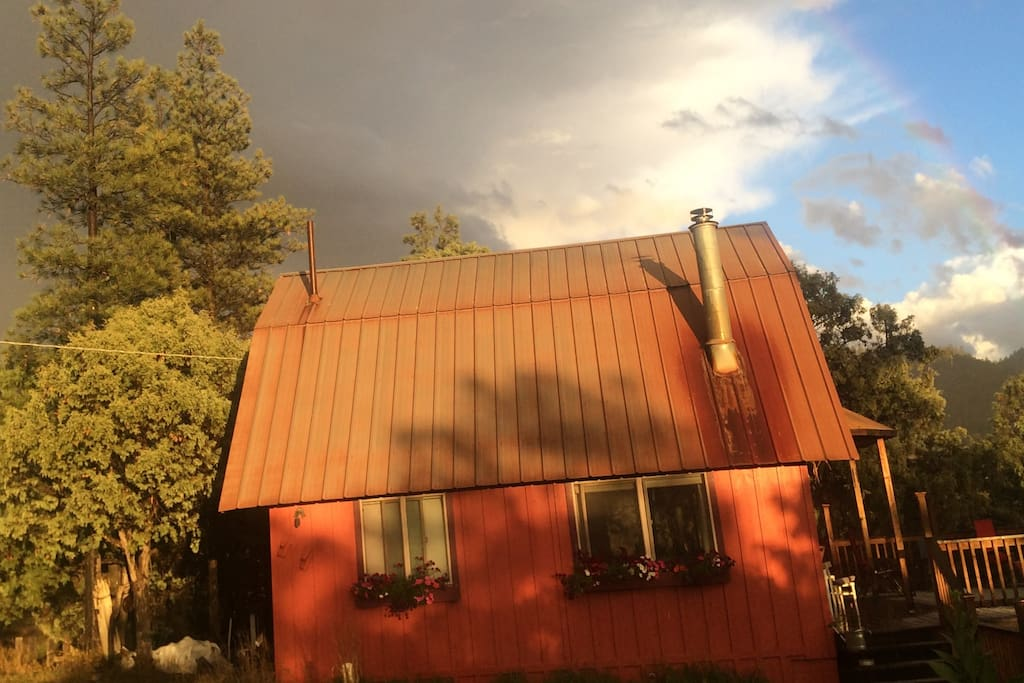 Our 2 bedroom cabin sits on hill facing south onto the valley, overlooking the Lower Blanco River.