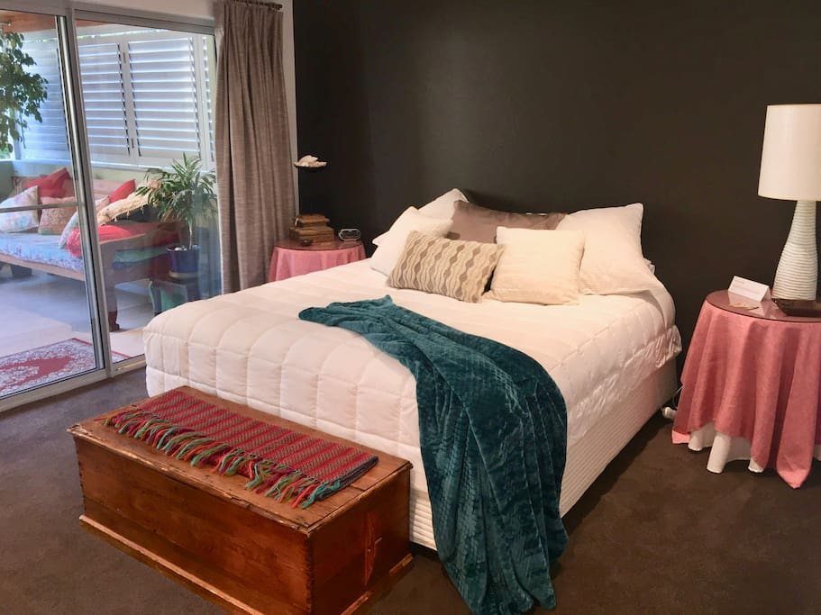 Luxury linens and a view to the balcony from the king size bed