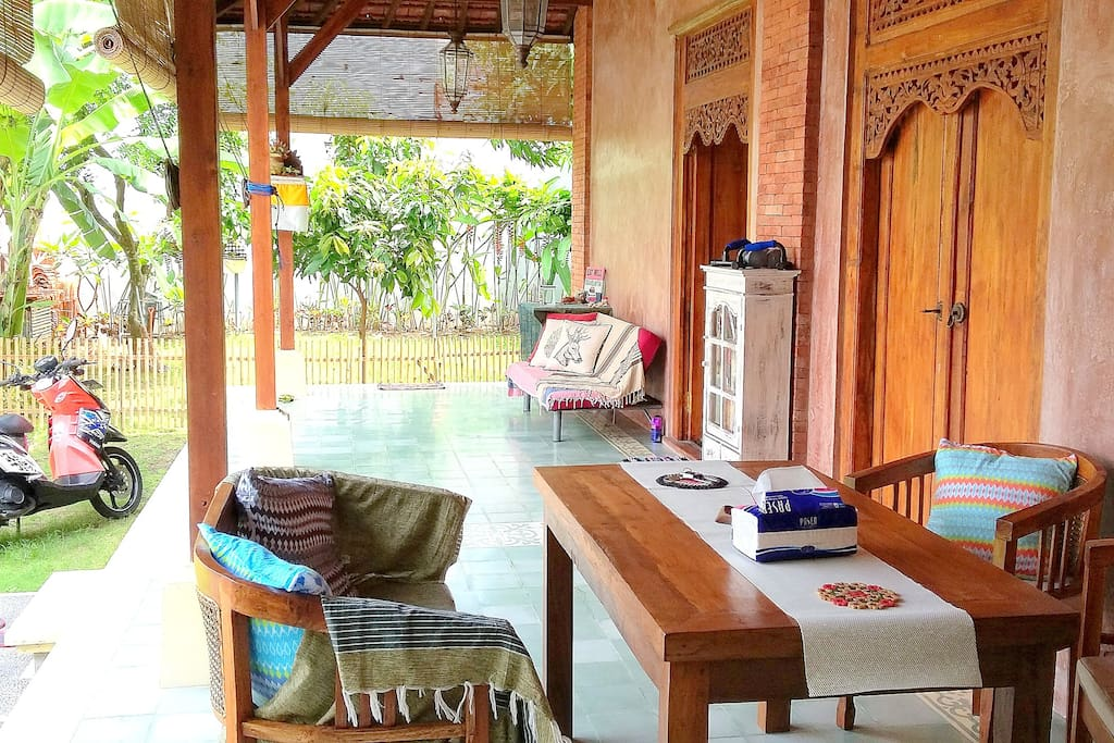 Open veranda comes with dining room and lazy sofa
