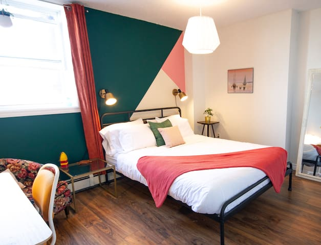 The bedroom features a queen size bed and closet and dresser for use during your stay.