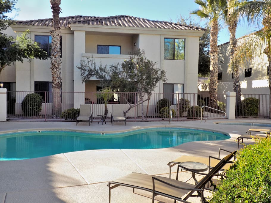 Two pristine pools with spa and lovely grounds available in this gated community.