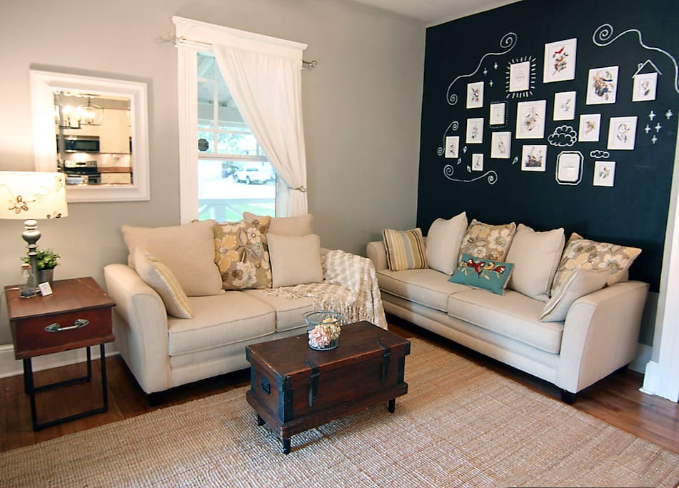 Relax in the cozy living room featuring period antiques.