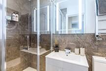 Main shower room and WC with washing machine. It's located in the corridor, just opposite door from bedroom 2.