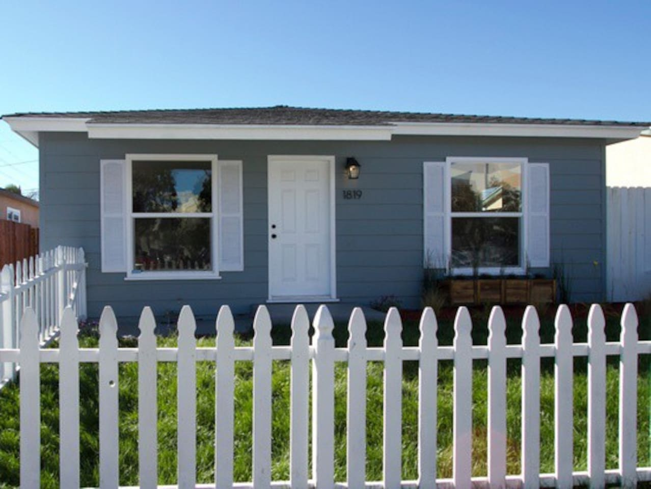 White picket fence in front