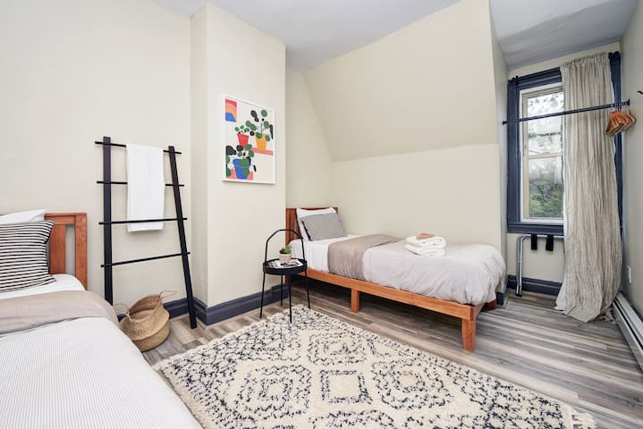 Twin bed retreat offers clean towels and sheets, luggage racks and natural lighting