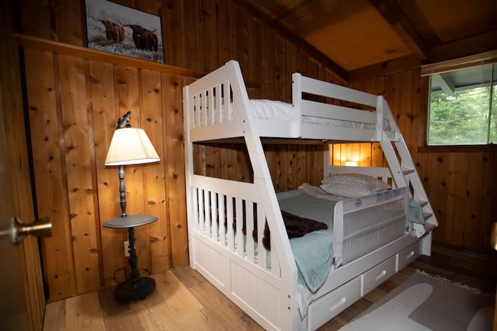 Bedroom 3, single over double bed. The kids bedrail is not normally on, it can be found in the master bedroom closet if you need it.