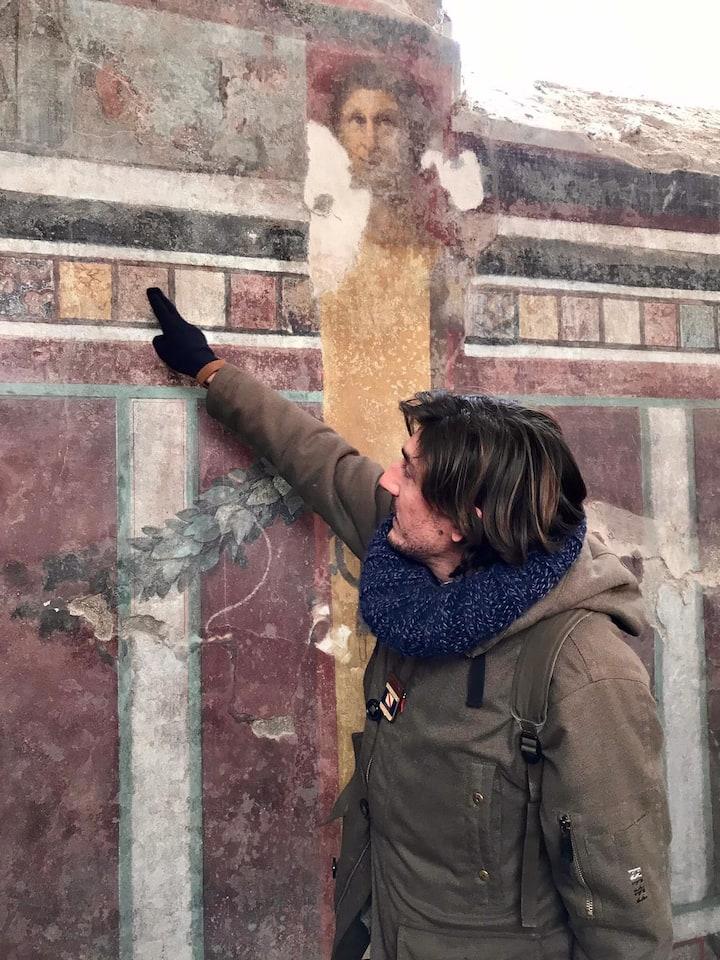 Roberto showing original frescos