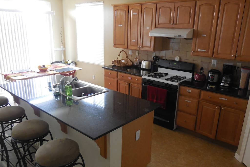 Dining, breakfast bar, and kitchen areas.