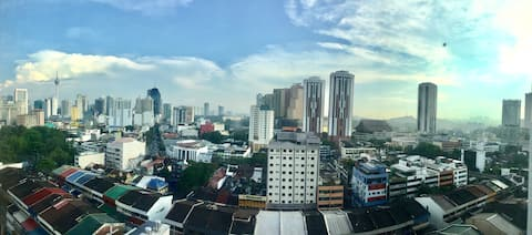Window view from the room: part of the City Skyline with KL Tower