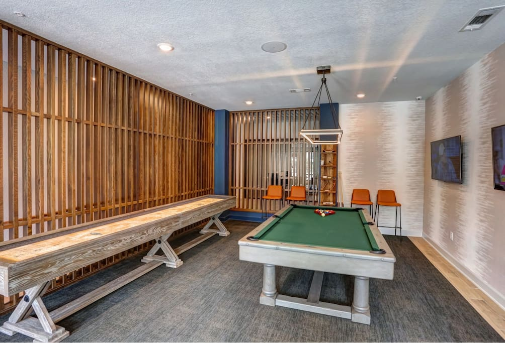 Modern game room, perfect for entertaining guest and relaxing after a long day!