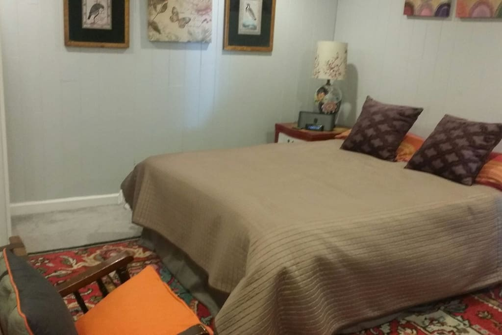 A large bedroom with a comfortable queen-size bed. Two wardrobe closets provide plenty of room for your belongings.