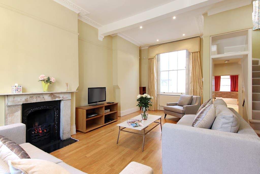 The light, spacious lounge with 2 great sofas, chairs, fireplace, flat screen TV, Freeview channels and Free WiFi