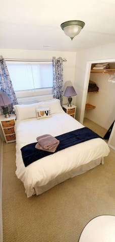 Comfortable queen sized bed, extra blankets, towels, iron and board provided