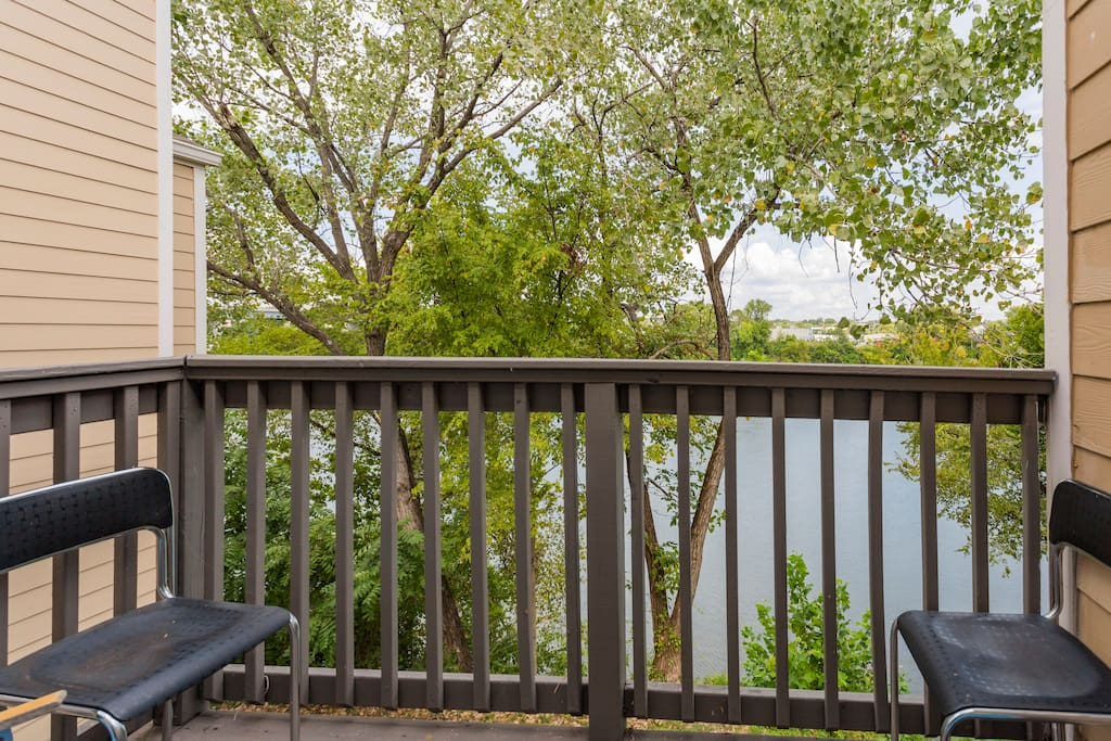 Private deck with sitting area on deck overlooking the river.