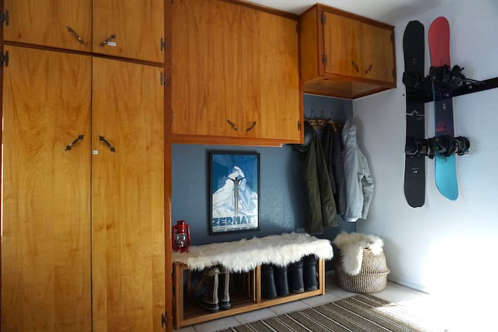 Our Ski/Snowboard room is perfect after a long day on the mountain. Store boards, boots, coats, etc + washer and dryer!