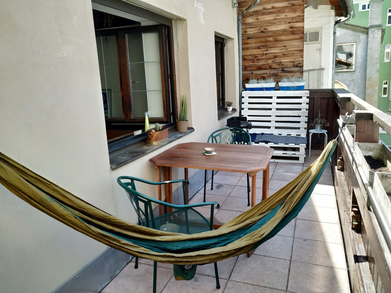 our balcony with a Dining table and comfortable spots to hang out
