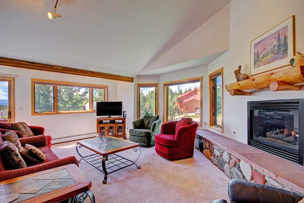 Open living room with gorgeous views - Living area features gas fireplace.