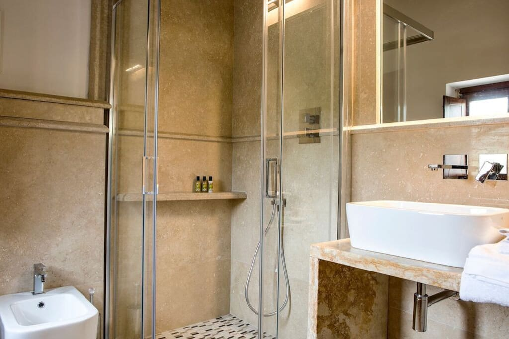 Italian Marble bathrooms give the luxurious feel all with walk in showers and stunning organic olive oil toiletries
