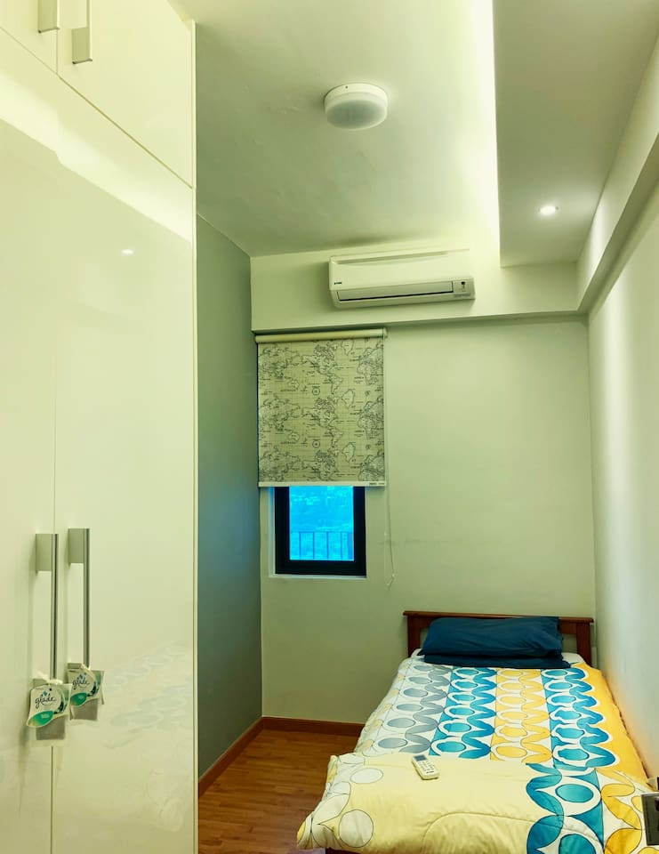 Aircond room with single bed and a wardrobe.