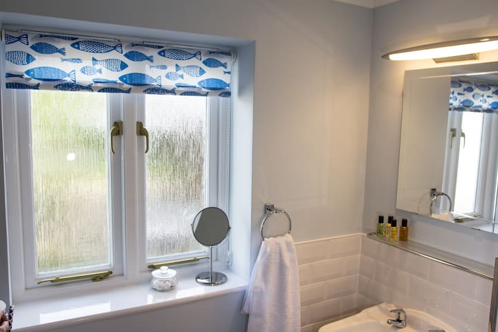 Bathroom with fluffy cotton towels and Cole & Lewis toiletries provided.