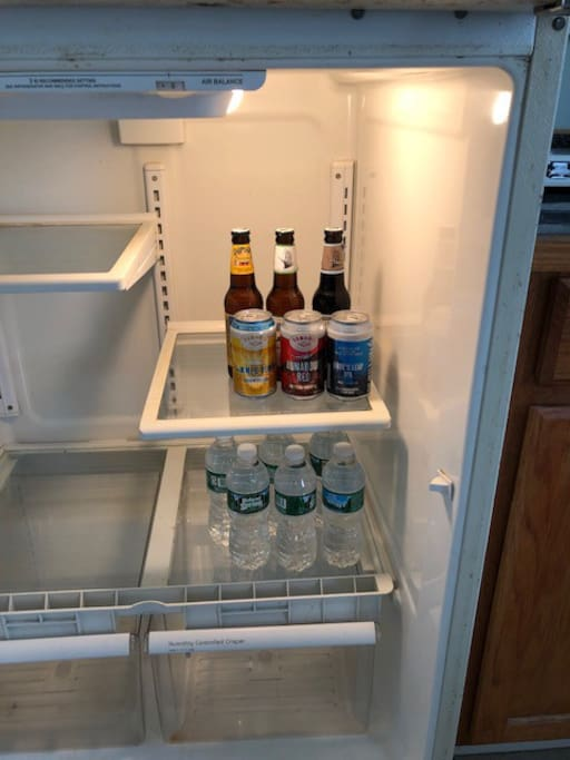 Fridge comes stocked with a 6-pack of local beer and bottled water