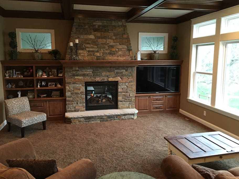 Open living room with double sided fireplace