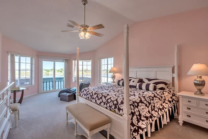 The master bedroom with an unbelievable view over the Halifax River