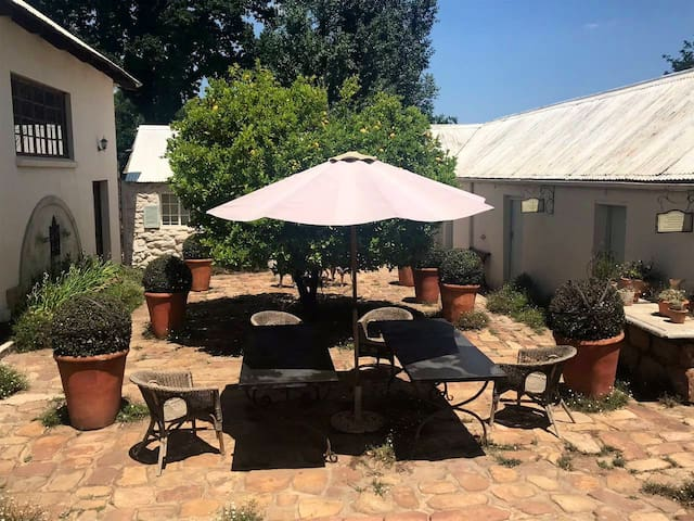Lazy days can be spend while eating al fresco  in the courtyard.