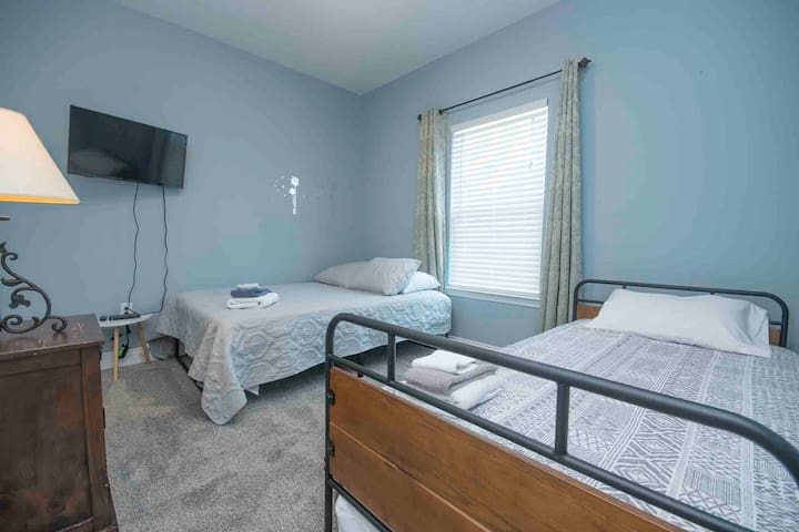 Kids room features a full size bed and twin trundle bed