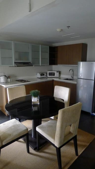 Kitchenette with 2 burner stovetop, full-sized refrigerator, microwave oven, toaster, hot water pot, hot water. Rice cooker and coffee maker and blender also available in cabinet below.