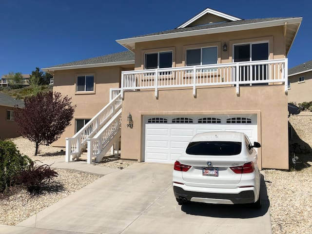 Front view of the house. Master suite above the garage. (BMW not included)