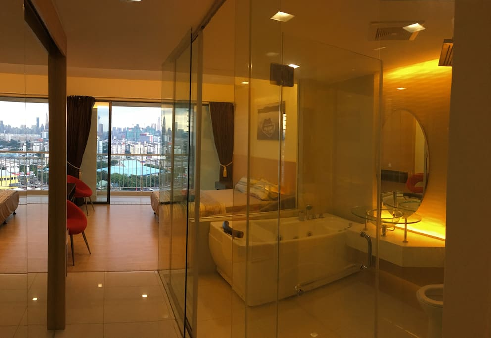 All glass bathroom with Jacuzzi