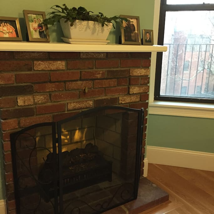 Electric fireplace for added ambiance and extra warmth.
