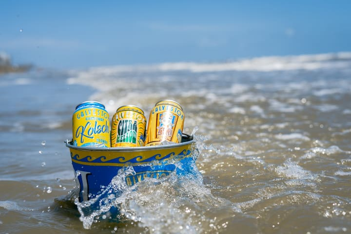 Grab a 6 pack and head to the beach! The Beer Haus is next door to a brewery and a block from Galveston beaches.