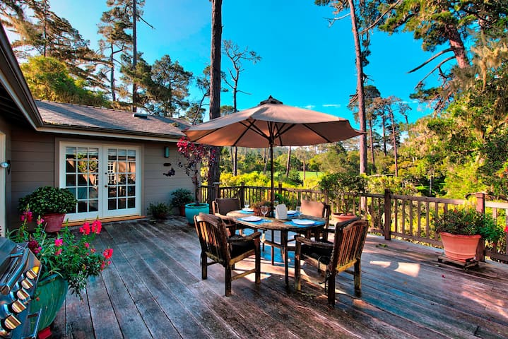 Spacious private deck with filtered views of golf course greens.