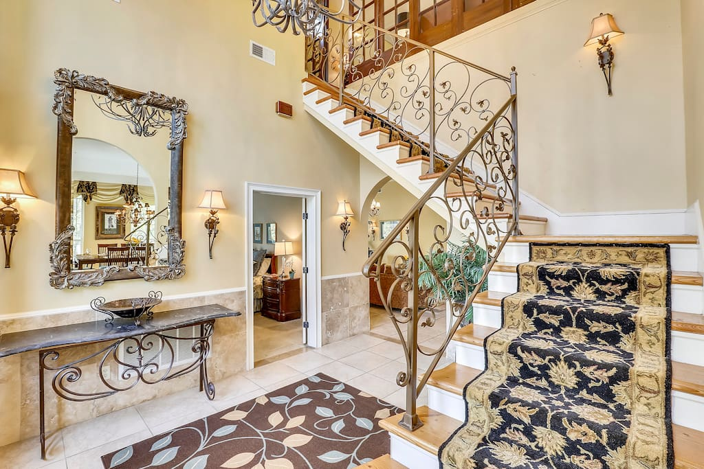 Entranceway with beautiful stairway