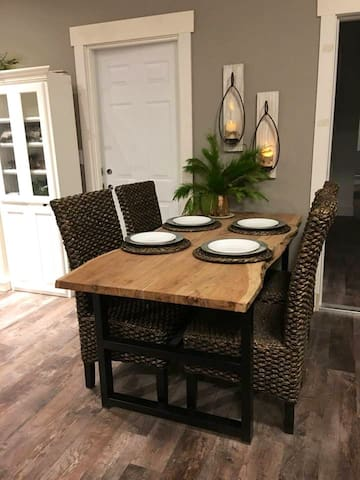 Dining area with natural edge wood and iron table