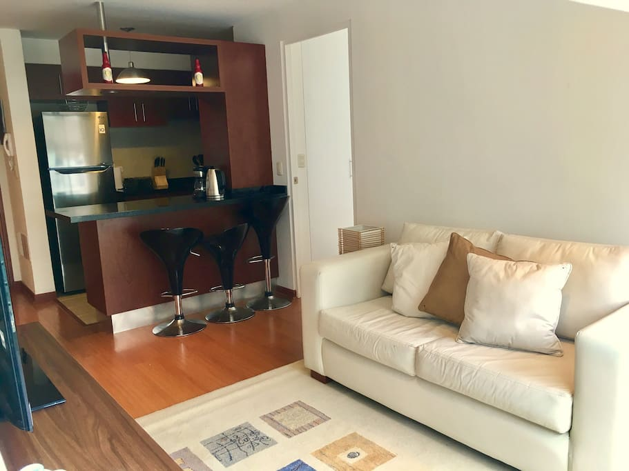 """Living Room - Tv area with free Netflix and a PS3 for your own use.  42"""" Rv wirh cable access."""