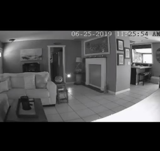 The view of the only interior camera located on the property. Positioned to capture the entryway of the main common area/livingroom.