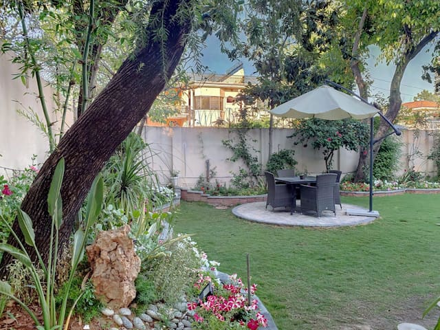 Relax under the loquat trees in the heart of Islamabad