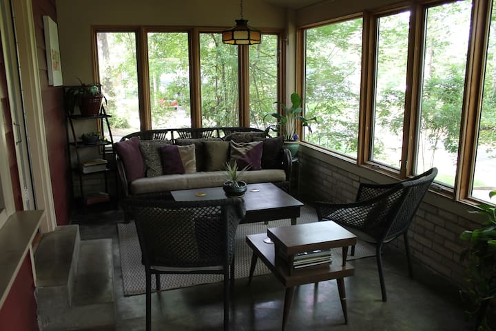 Comfy sun room for reading, relaxing, conversations and board games