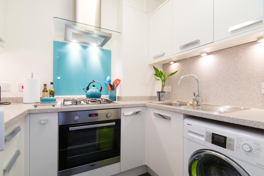 Fully equipped kitchen with oven hob microwave kettle toaster and filter coffee maker