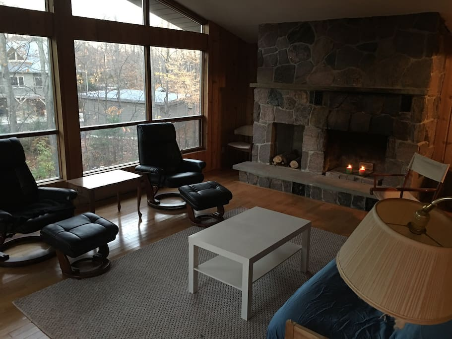 Beautiful open room.  Fireplace is not wood functional.  It's filled with candles for ambiance.