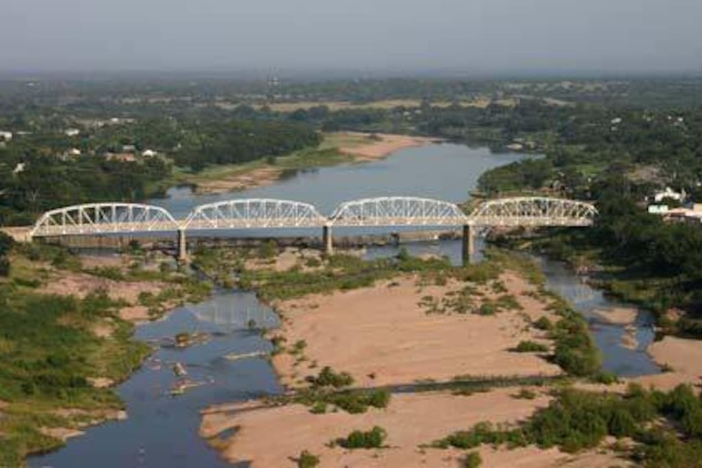 An aerial view of the Llano bridge and river where The Dabbs is located