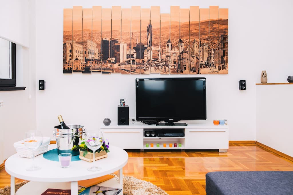 Living room  decorated with beautiful landscape of Sarajevo